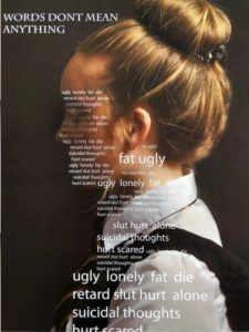 A photograph of a schoolgirl with negative words over her figure